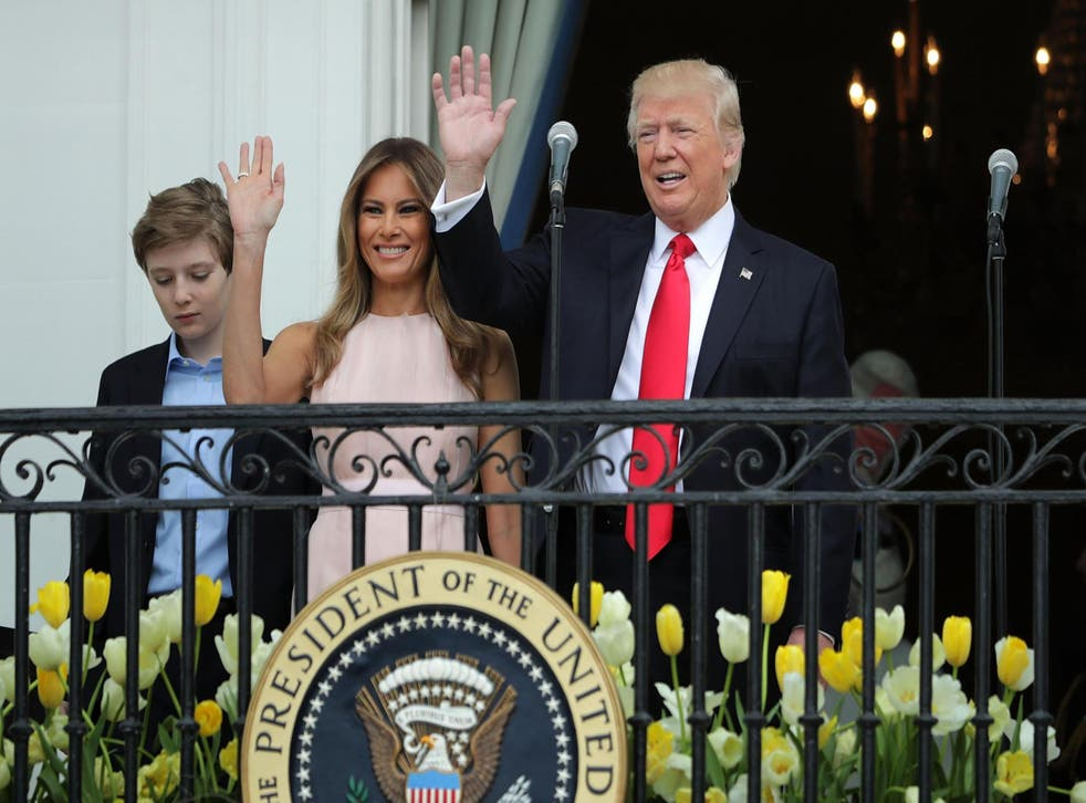 Picture: President Donald Trump and first lady Melania Trump wave to guests from the Truman Balcony with their son Barron Trump during the 139th Easter Egg Roll on the South Lawn of the White House April 17, 2017 in Washington, DC