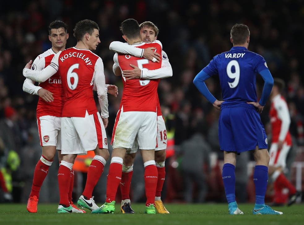 Arsenal's players celebrate after the final whistle