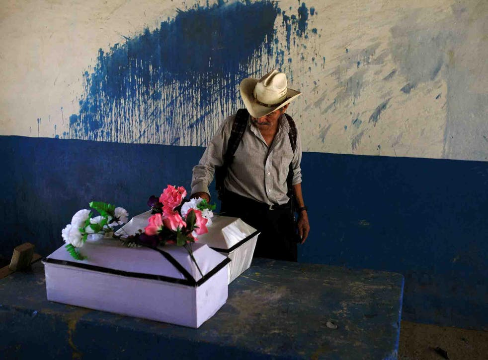The remains of Petrona Chavarria and Vilma Ramos, who died in the El Mozote massacre, prior to their burial in the town of Jocoatique, in El Salvador