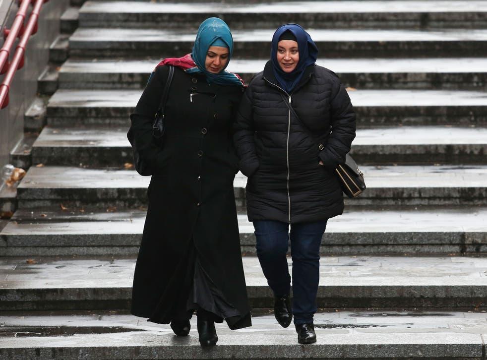 Women wearing headscarves walk on the street on December 1, 2016 in Vienna, Austria.