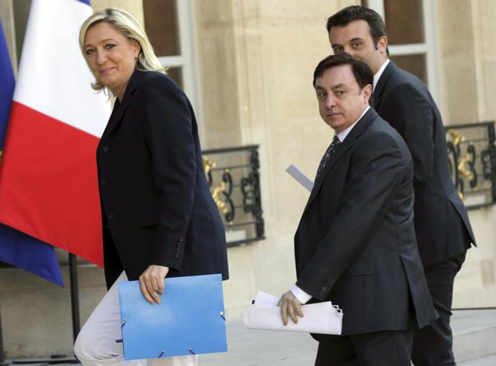 Marine Le Pen arrives at the Elysee Palace in Paris with National Front Vice-Presidents Jean-Francois Jalkh (centre) and Florian Philippot
