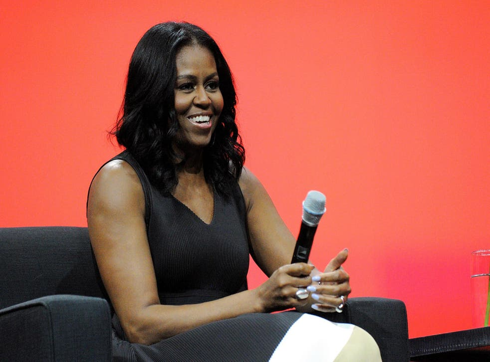 Michelle Obama smiles during a conversation at the AIA Conference on Architecture 2017