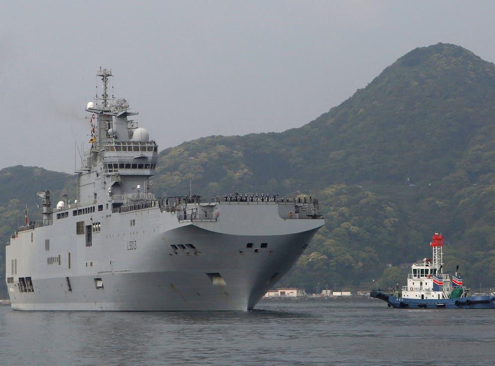 French amphibious assault ship Mistral (L) arrives at Japan Maritime Self-Defense Force's Sasebo naval base in Sasebo