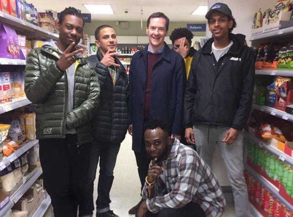 George Osborne poses with a group of youths in a supermarket
