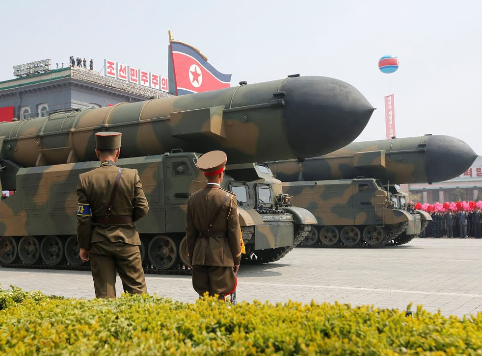 Missiles are driven past the stand with North Korean leader Kim Jong-un and other high ranking officials during a military parade in Pyongyang