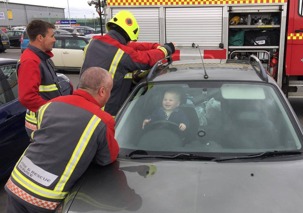 toddler laughs as five firefighters try to free him from locked car