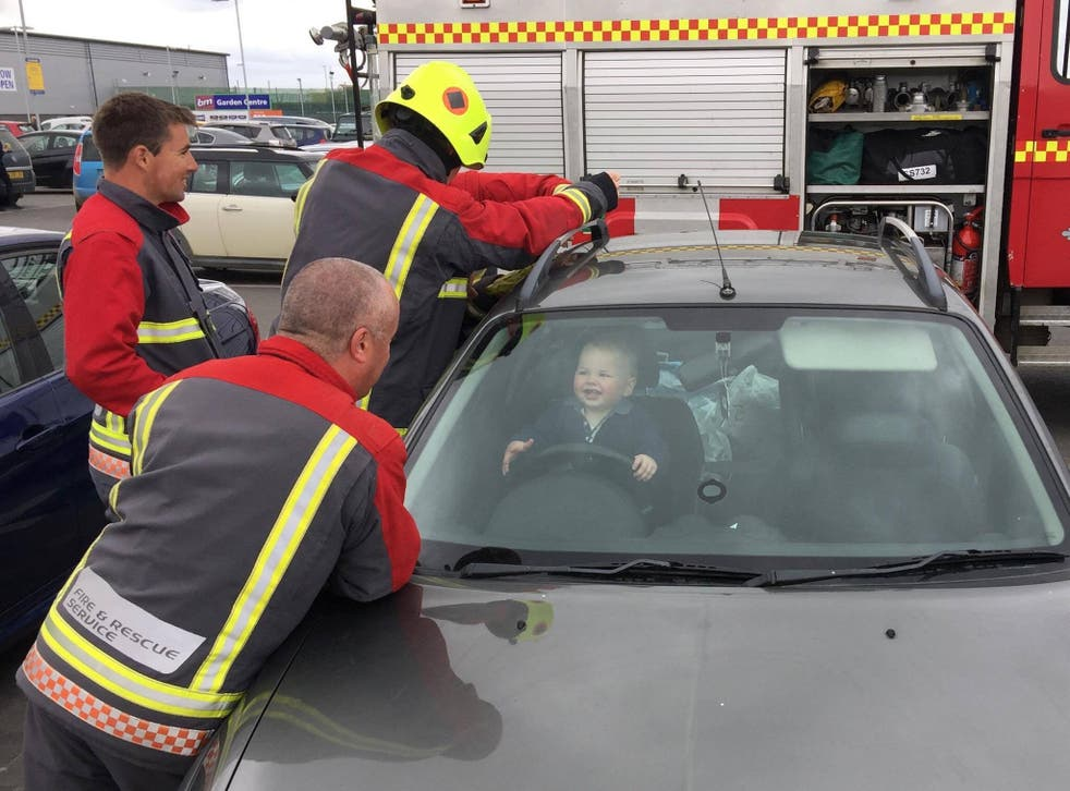 Firefighters rescuing 14-month-old Brandon from his mother's car in Bude, Cornwall