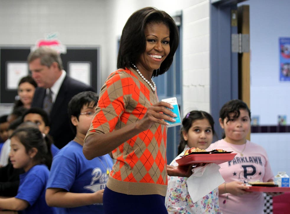 Michelle Obama campaigned for rules restricting levels of salt, fat and sugar in school meals