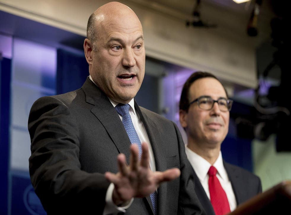 National Economic Director Gary Cohn, left, accompanied by Treasury Secretary Steve Mnuchin, speaks in the briefing room of the White House