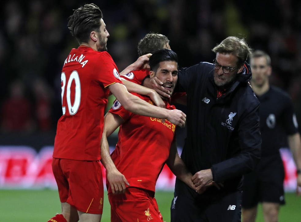 Jurgen Klopp celebrates with Emre Can after the player's stunning goal