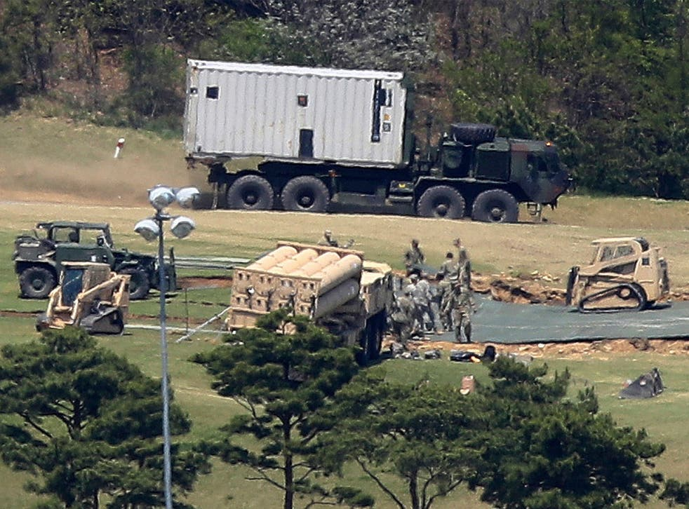 US Army soldiers installing the THAAD system at a golf course in Seongju in April