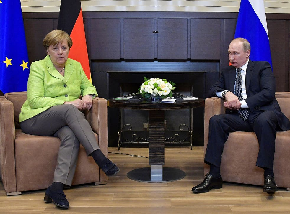 Russian President Vladimir Putin meets with German Chancellor Angela Merkel at the Bocharov Ruchei state residence in Sochi, Russia