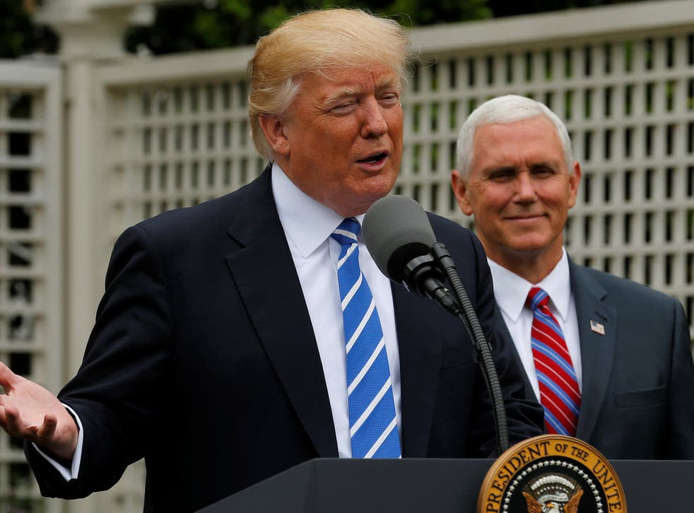 President Donald Trump, flanked by Vice President Mike Pence