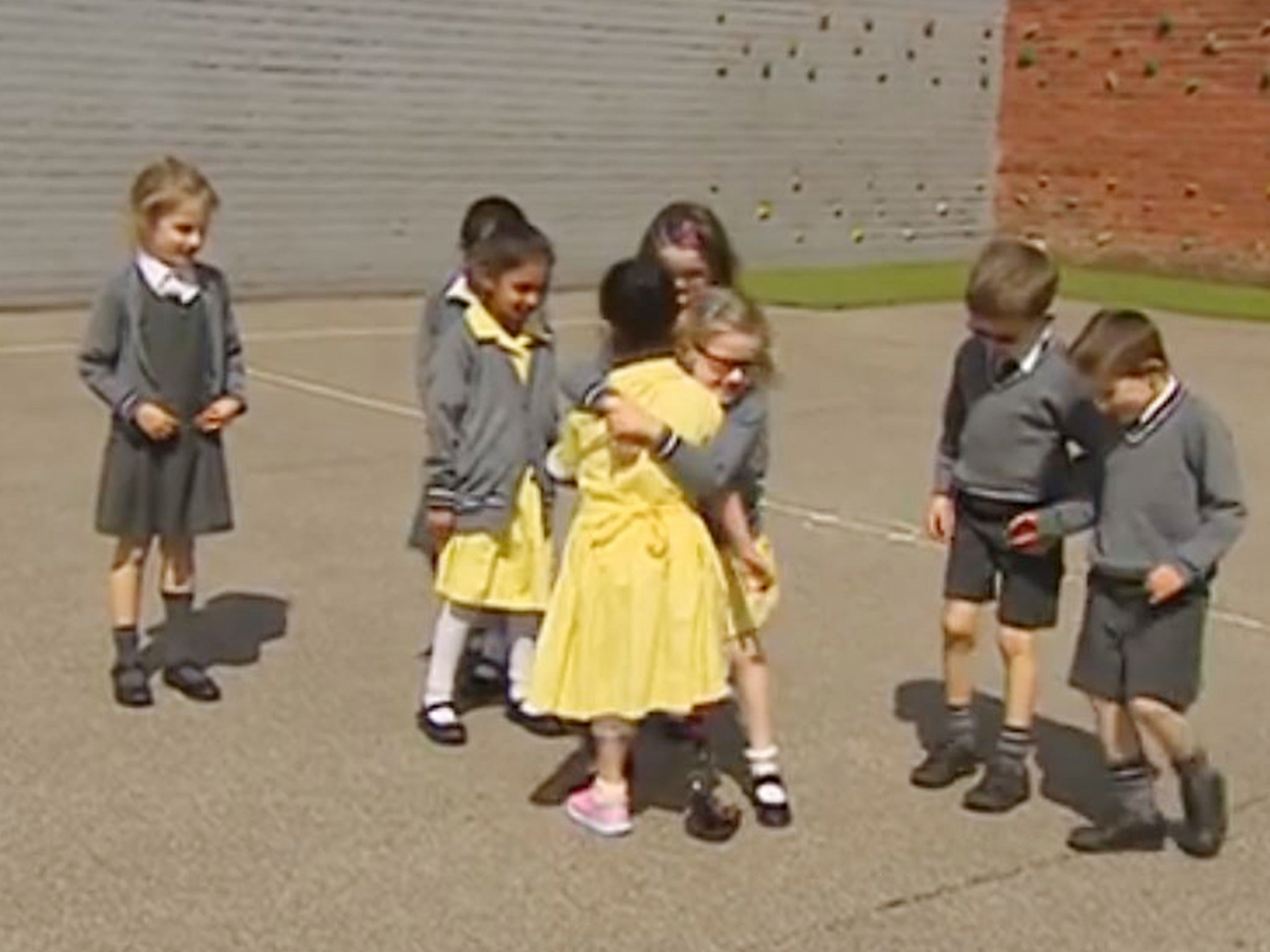 seven-year-old girl shows friends her new prosthetic leg for first