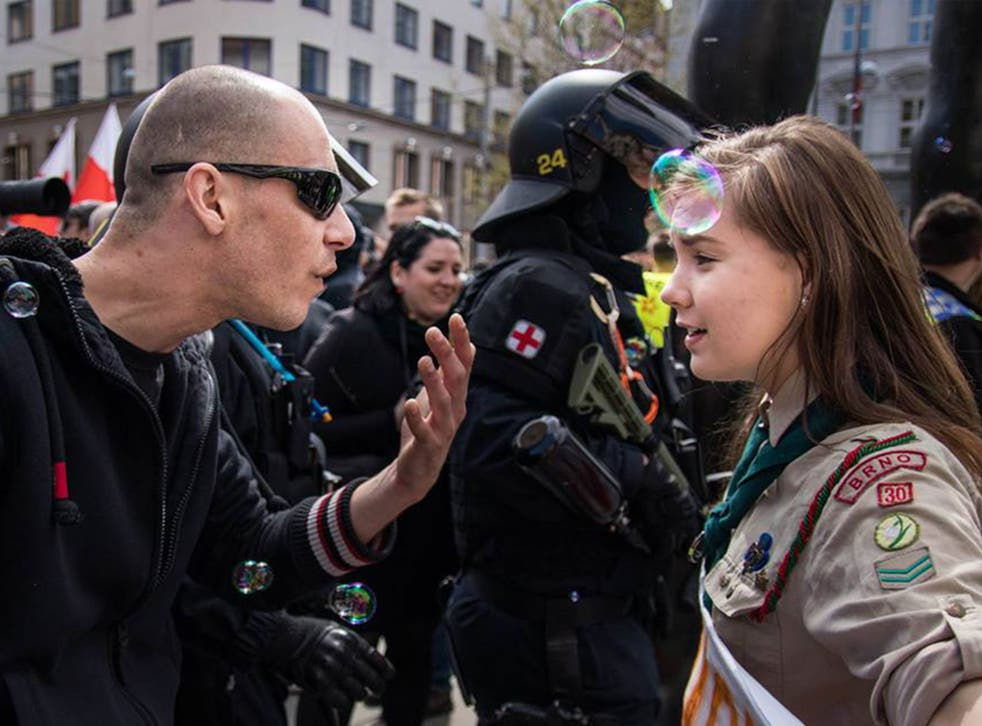 A young girl scout protesting against a far-right march in Brno