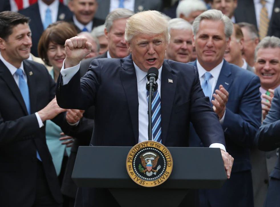 Donald Trump celebrates with Congressional Republicans in the Rose Garden of the White House after the House of Representatives approved the American Healthcare Act