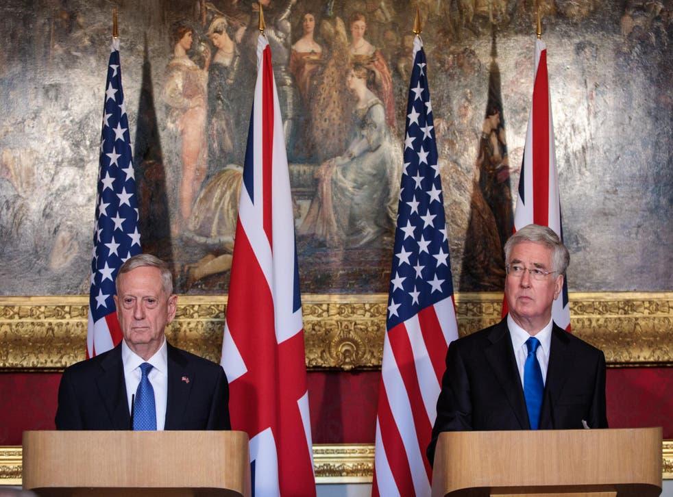 Sir Michael Fallon stands alongside US Defense Secretary James Mattis