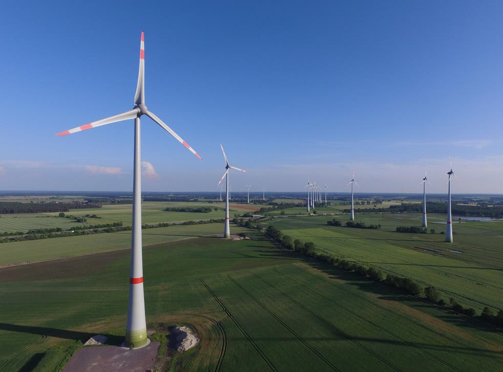 In this aerial view wind turbines spin on 8 June 2016 near Brueck, Germany