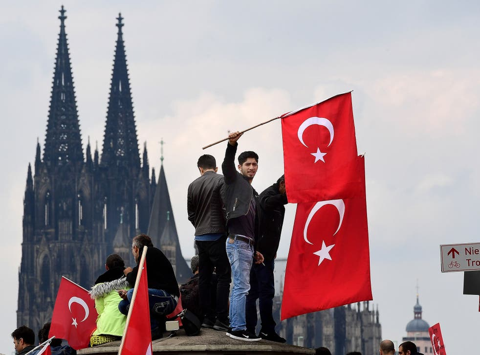 Hundreds of President Erdogan's supporters have protested in Germany following the coup