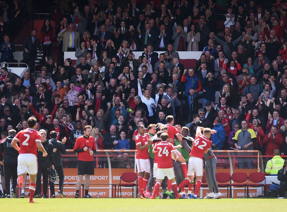 Forest celebrate remaining in the Championship at the end of the match