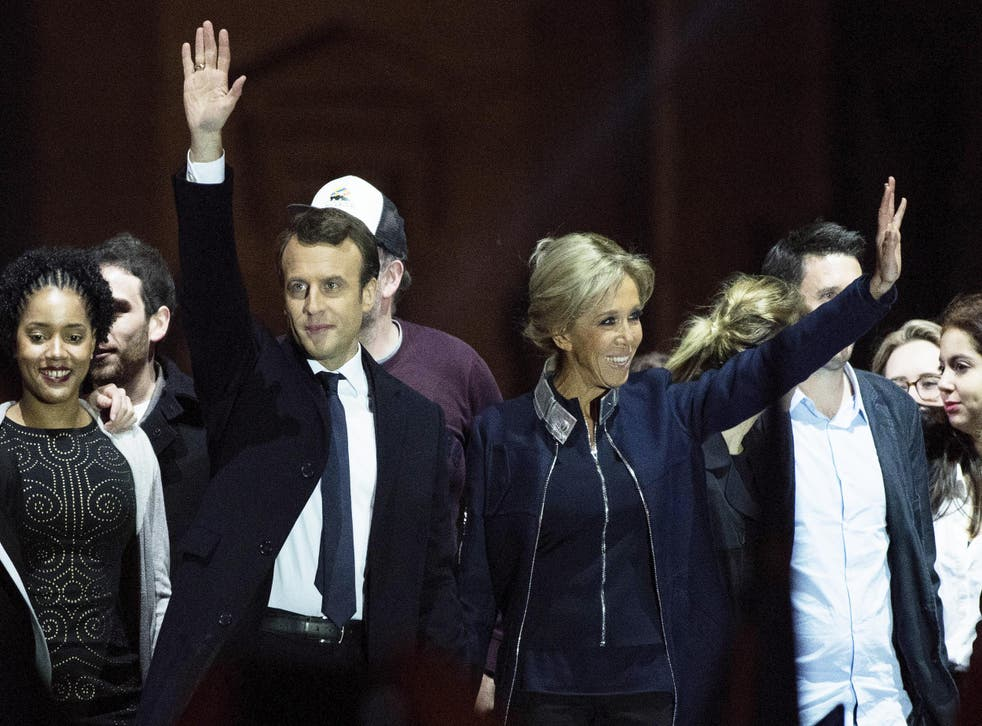Emmanuel Macron waves to supporters with wife Brigitte after winning the French Presidential Election