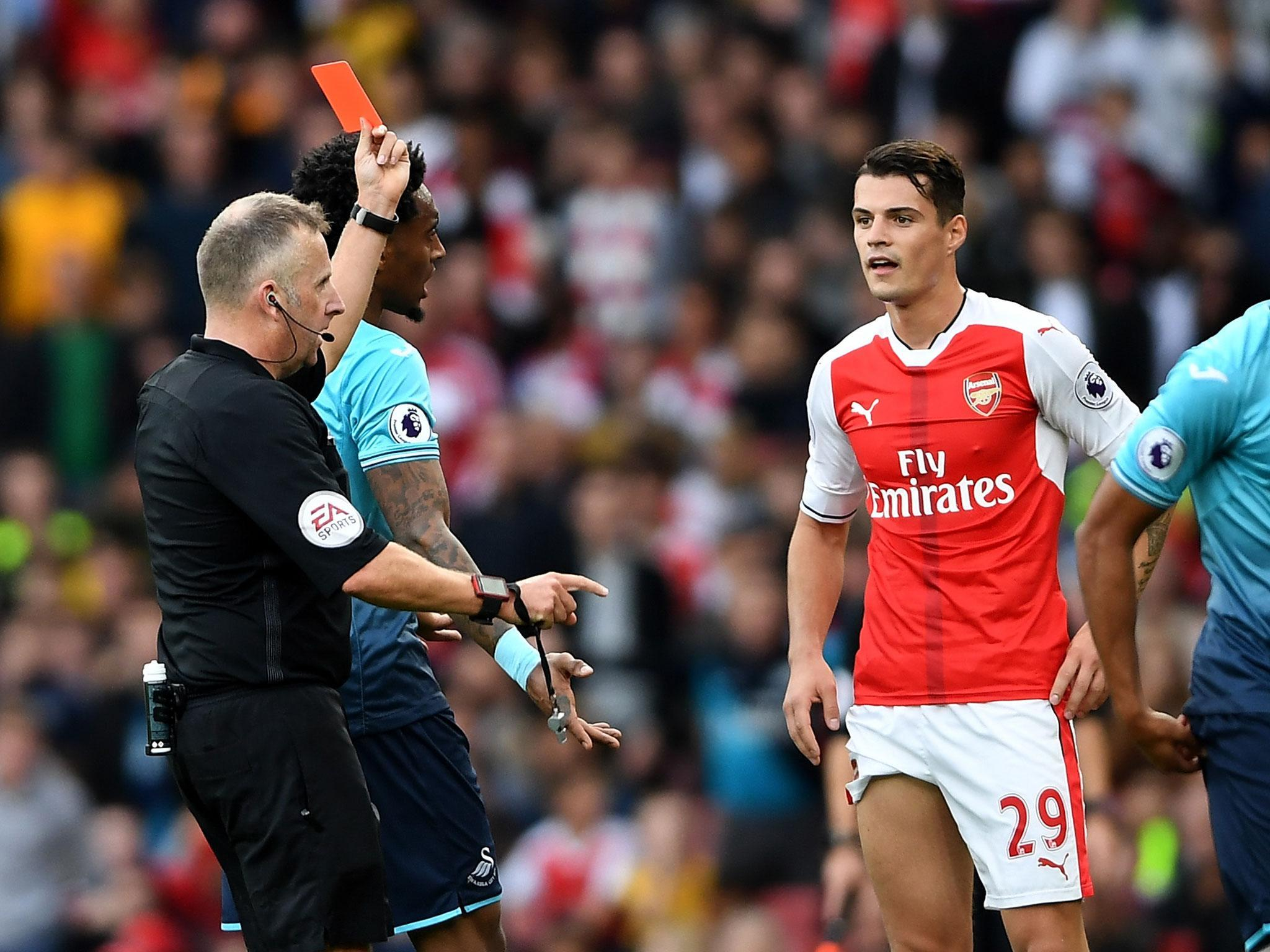 Arsenal s Granit Xhaka won t curb his aggressive style despite
