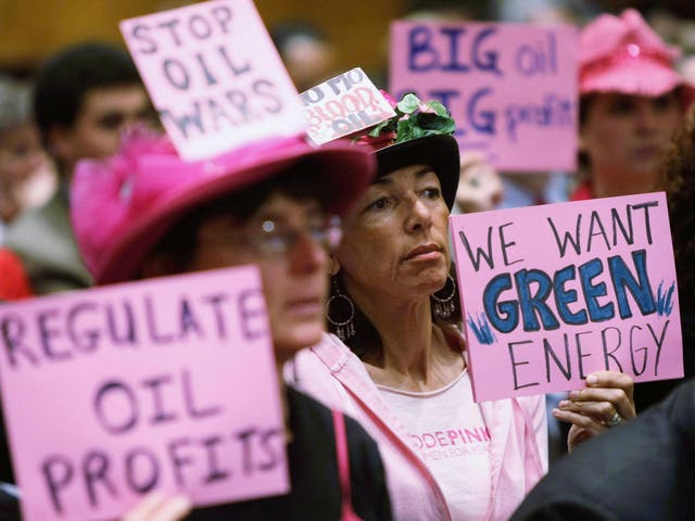 Code Pink members Desiree Farooz (C) and Toby Blome (L) protests during a hearing of the Senate Judiciary Committee in 2008