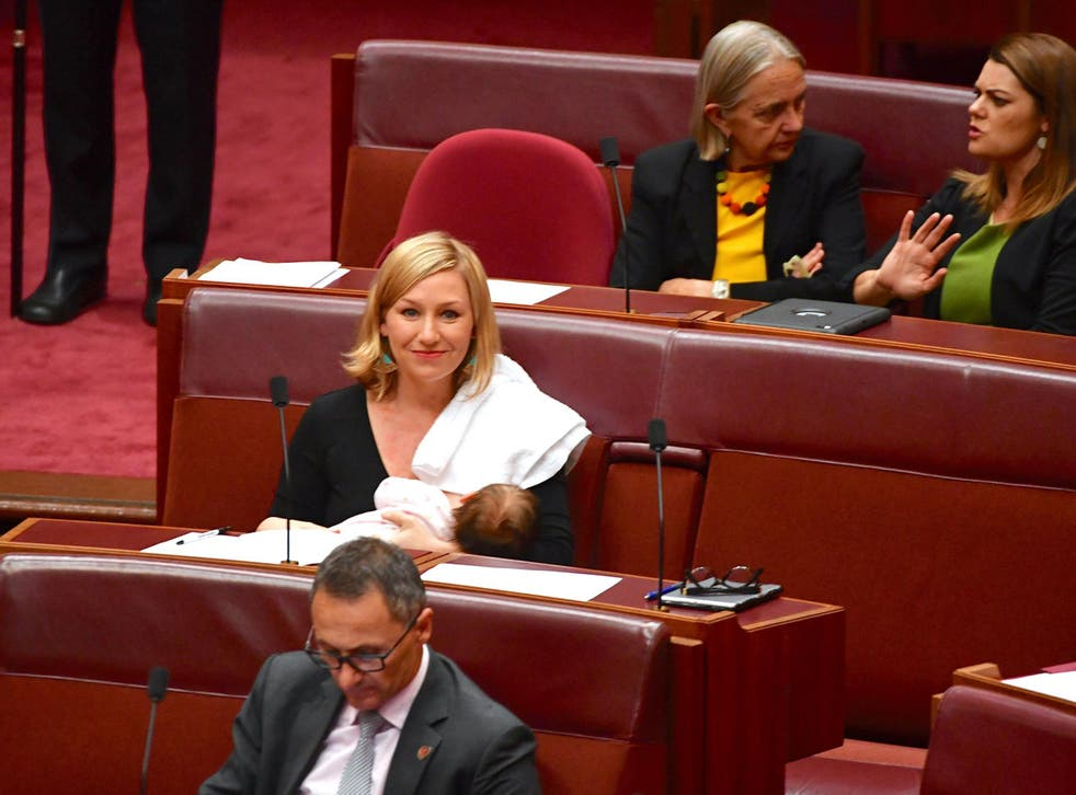 Australian Senator Larissa Waters reacts as she breastfeeds her baby in the Senate Chamber at Parliament House in Canberra