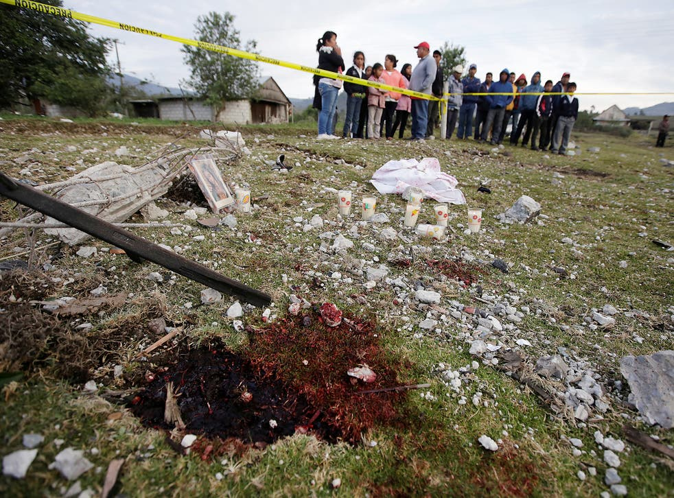 A blood stain is seen at the site of the explosion of a house where fireworks were stored in the town of San Isidro, Chilchotla