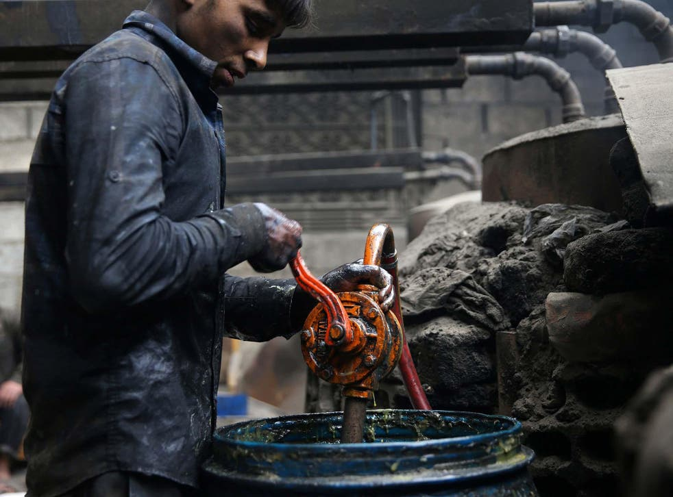 Khodor, 20, extracts fuel from plastic in a workshop in the rebel-held besieged Douma neighbourhood of Damascus