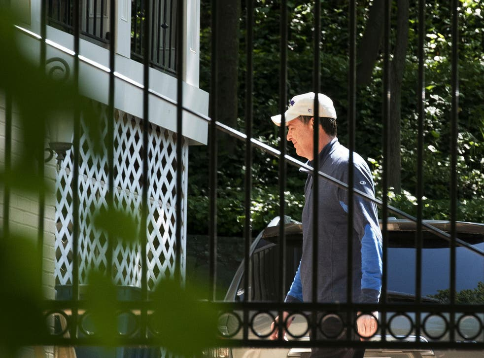 Mr Comey was photographed at his home outside of Washington after he was fired