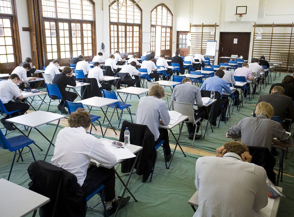Students sitting exams in secondary school