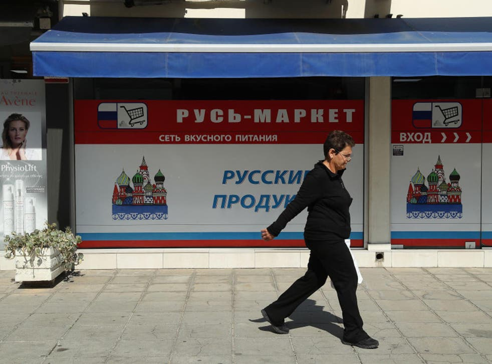 A customer exits a Russian supermarket in Limassol, Cyprus