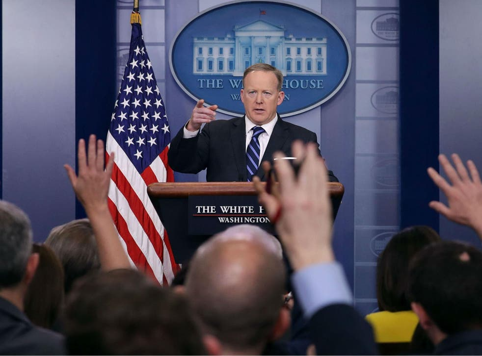 White House Press Secretary Sean Spicer calls on reporters during the daily news conference in the Brady Press Briefing Room at the White House April 10, 2017