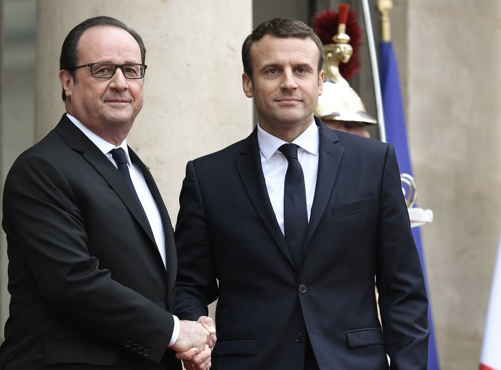 France's new President was greeted by his predecessor, François Hollande, outside the Elysee presidential palace