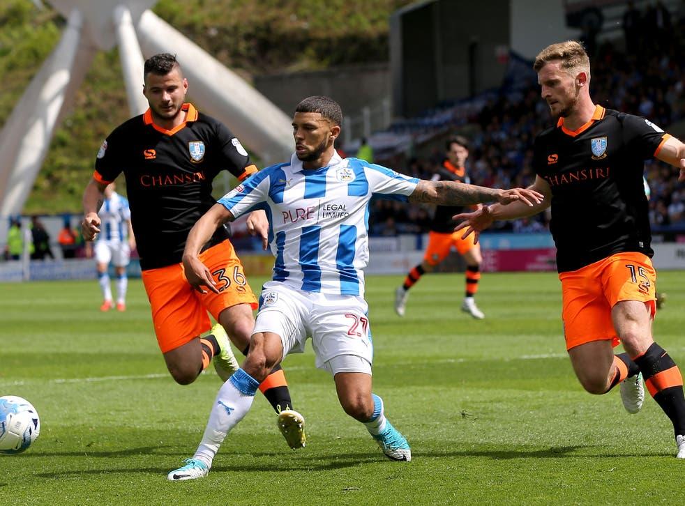 Nahki Wells is put under pressure inside the Sheffield Wednesday half
