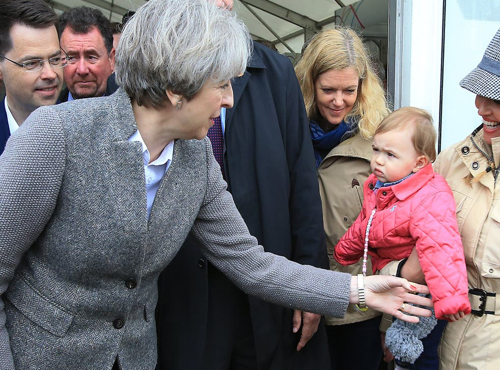 Prime Minister Theresa May greets a toddler