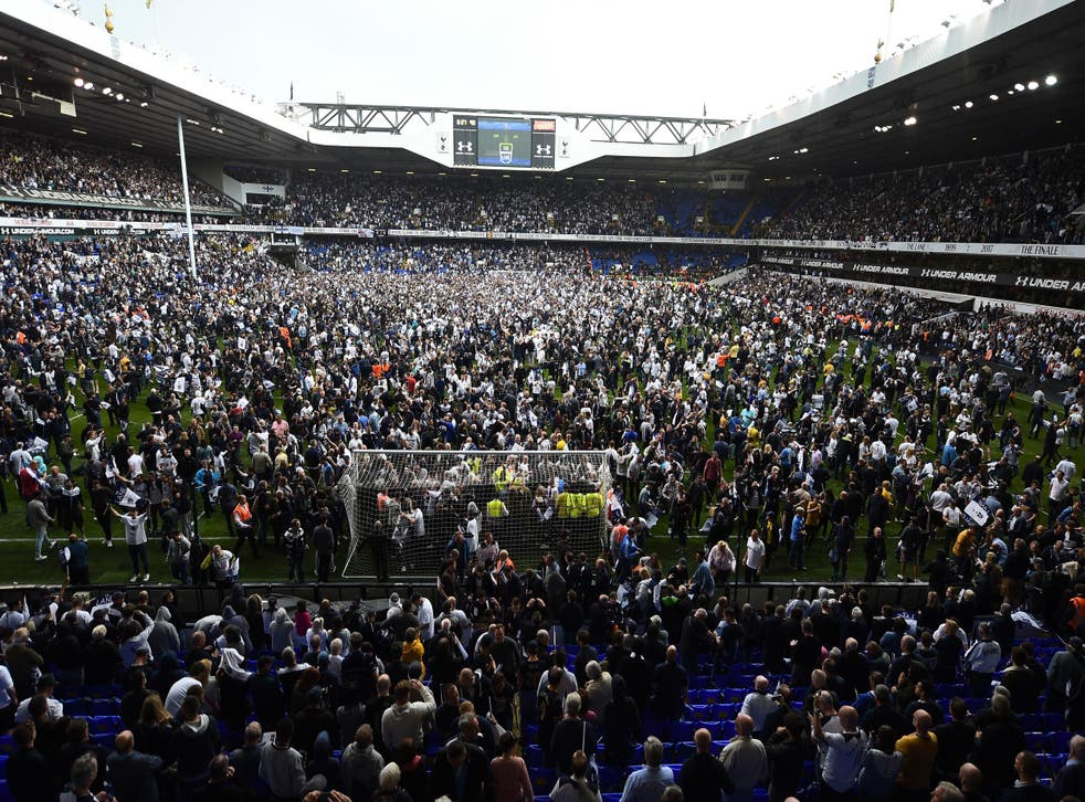 Tottenham's fans spill out on to the pitch after the final whistle at White Hart Lane