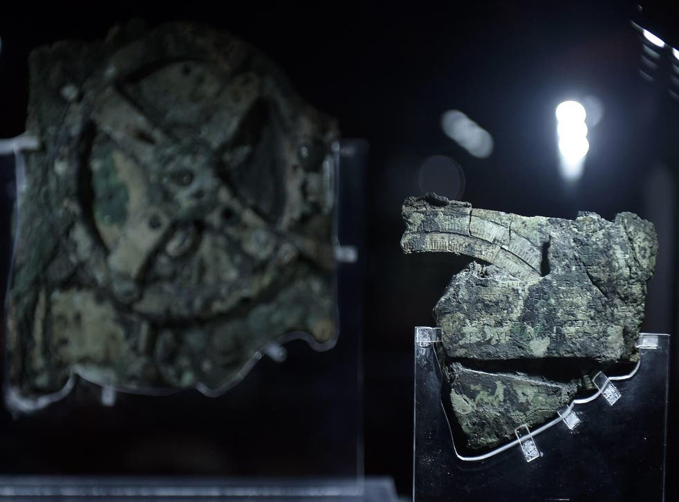 A picture taken at the Archaeological Museum in Athens on September 14, 2014 shows pieces of the so-called Antikythera Mechanism, a 2nd-century BC device known as the world's oldest computer, which was discovered by sponge divers in 1900 off a remote Greek island in the Aegean