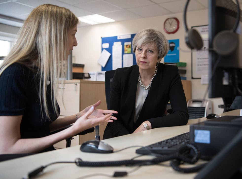 Theresa May meets a helpline adviser during a visit to the Young Minds mental health charity last week