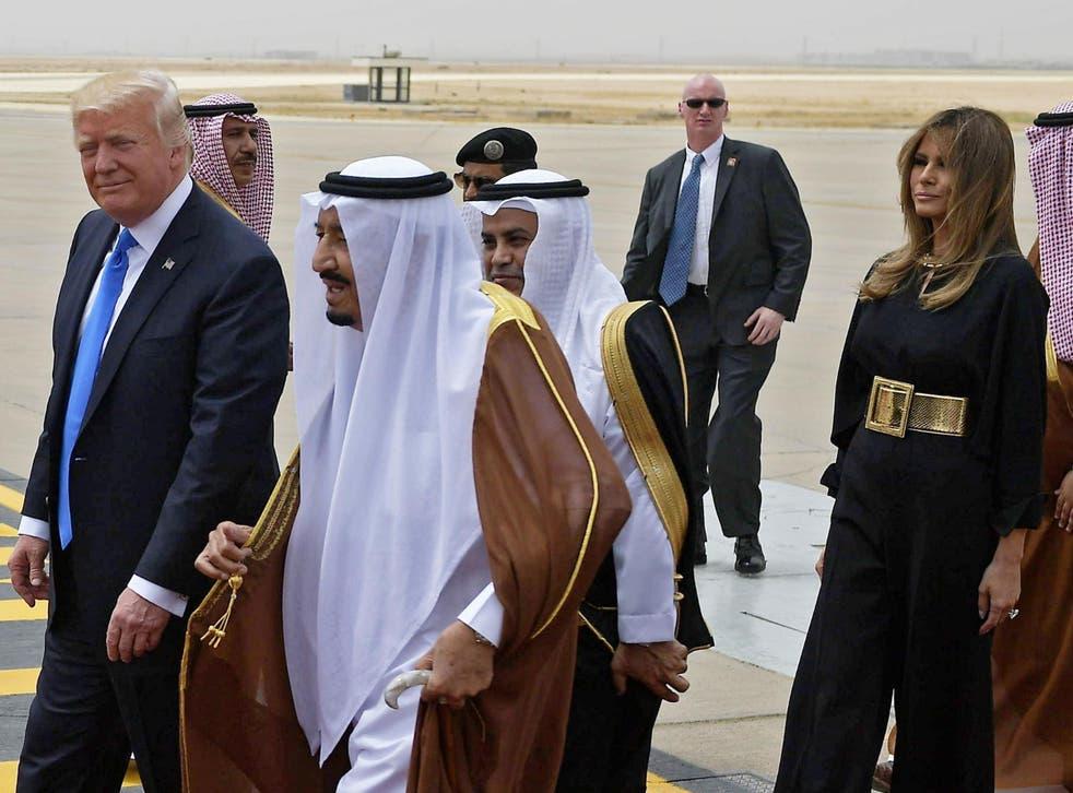 Donald Trump is welcomed by Saudi King Salman bin Abdulaziz al-Saud after arriving in Riyadh with his wife Melania