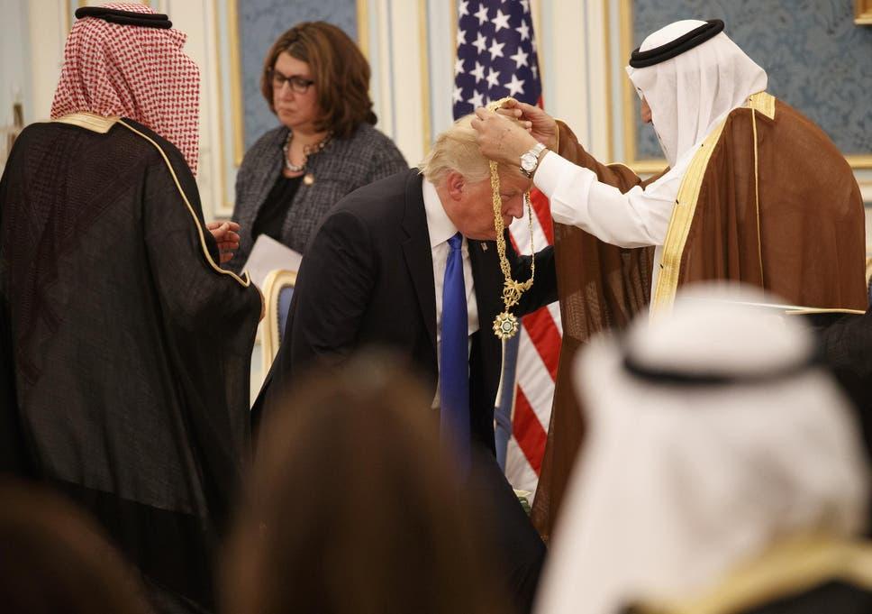 Saudi King Salman presents President Donald Trump with The Collar of Abdulaziz Al Saud Medal at the Royal Court Palace