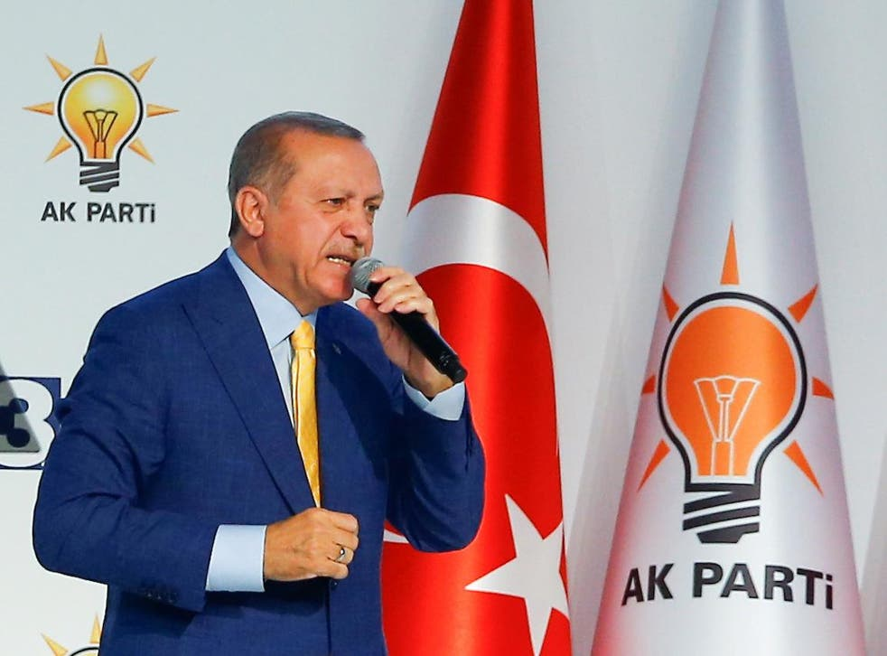 Turkish President Recep Tayyip Erdogan makes a speech during the Extraordinary Congress of the ruling AK Party in Ankara on 21 May 2017