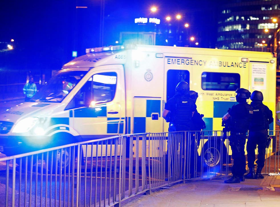 Armed police officers stand near the Manchester Arena, where US singer Ariana Grande had been performing when the attack took place