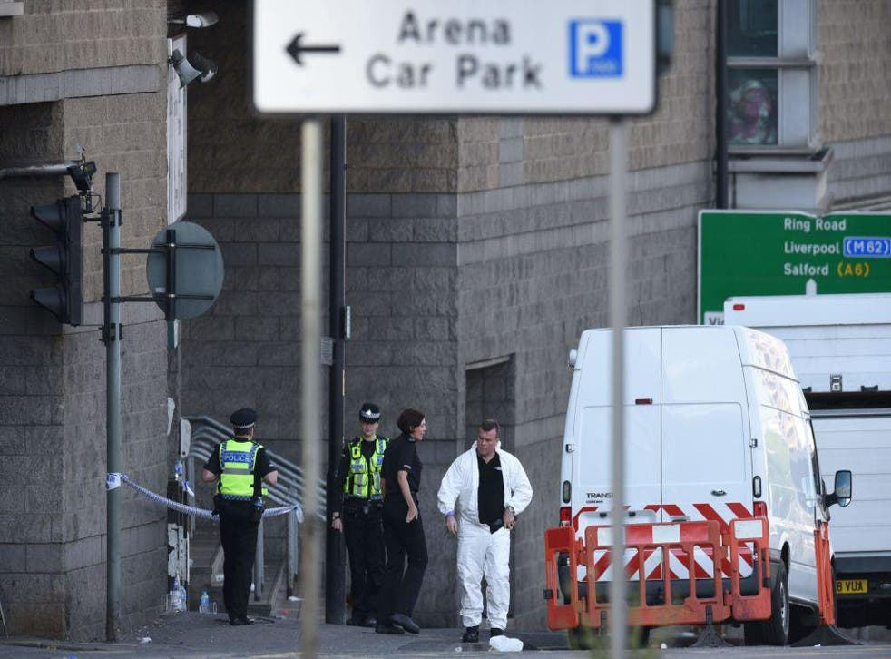 Members of the emergency services work near Manchester Arena following a terror attack at an Ariana Grande concert