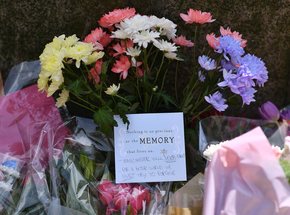 Floral tributes are arriving at the scene in Manchester, where 22 people have been confirmed to have lost their lives