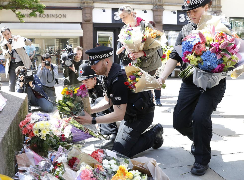 Flowers are left in St Ann's Square, Manchester, the day after a suicide bomber killed 22 people, including children