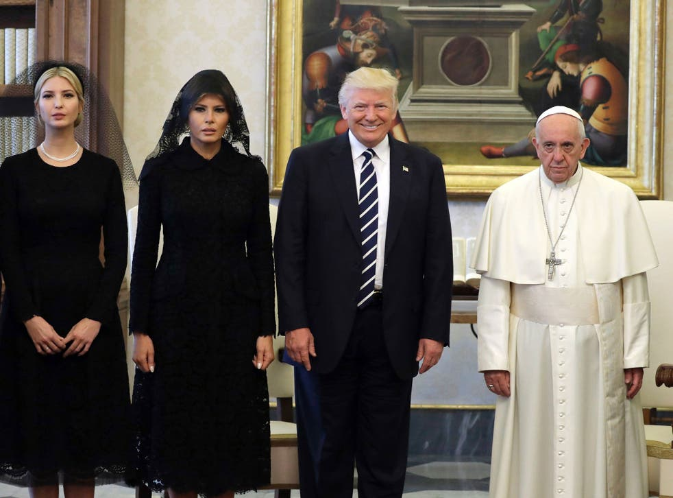 Pope Francis poses with US President Donald Trump, First Lady Melania Trump and the daughter of Ivanka Trump at the end of a private audience at the Vatican