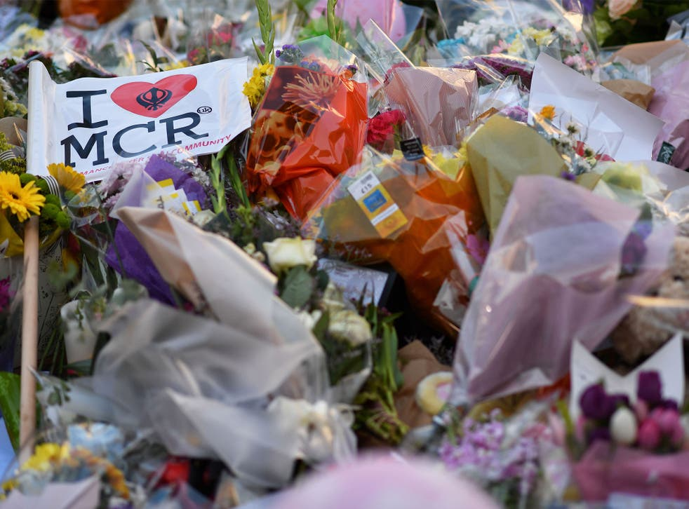 Flowers, messages and candles are pictured in St Ann's Square in Manchester in tribute to the victims of the 22 May terror attack