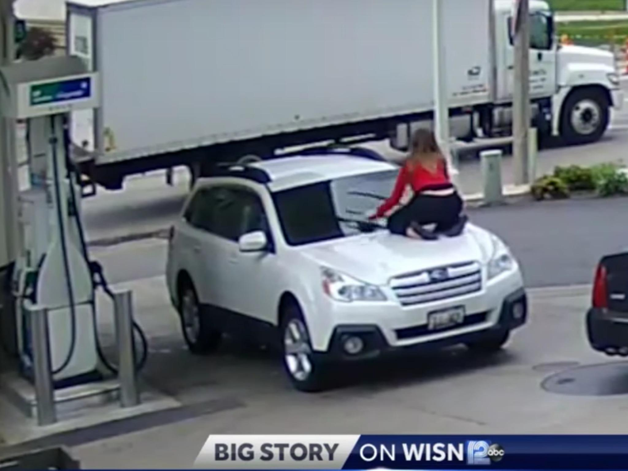 Woman Jumps Onto The Hood Of Moving Car To Prevent Carjacking At